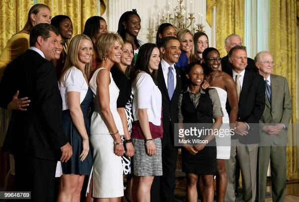 S President Barack Obama poses for a picture with the NCAA champion University of Connecticut women�s basketball team during a ceremony in the East...