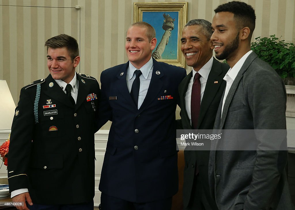 US President Barack Obama (2ndR) poses for a picture with US Army Specialist Alek Skarlatos (L), US Air Force Airman 1st Class Spencer Stone (2ndL), and Anthony Sadler (R) during a meeting in the Oval Office at the White House on September 17, 2015 in Washington, DC. The three friends are concidered heros for helping overpower a gunman on a Paris-bound train on August 21.