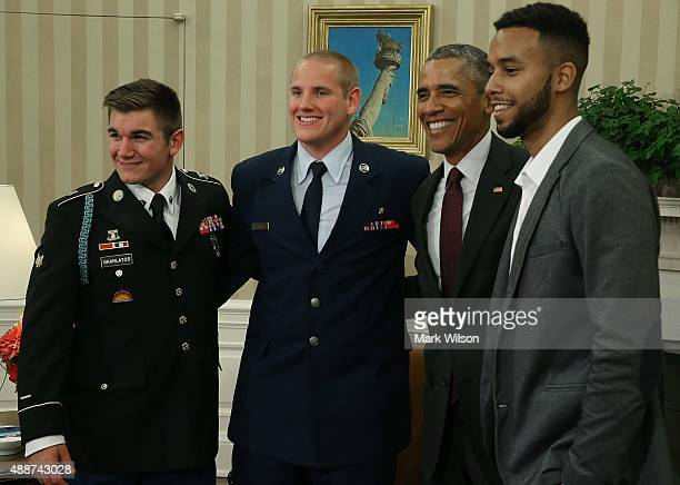 President Barack Obama poses for a picture with US Army Specialist Alek Skarlatos US Air Force Airman 1st Class Spencer Stone and Anthony Sadler...