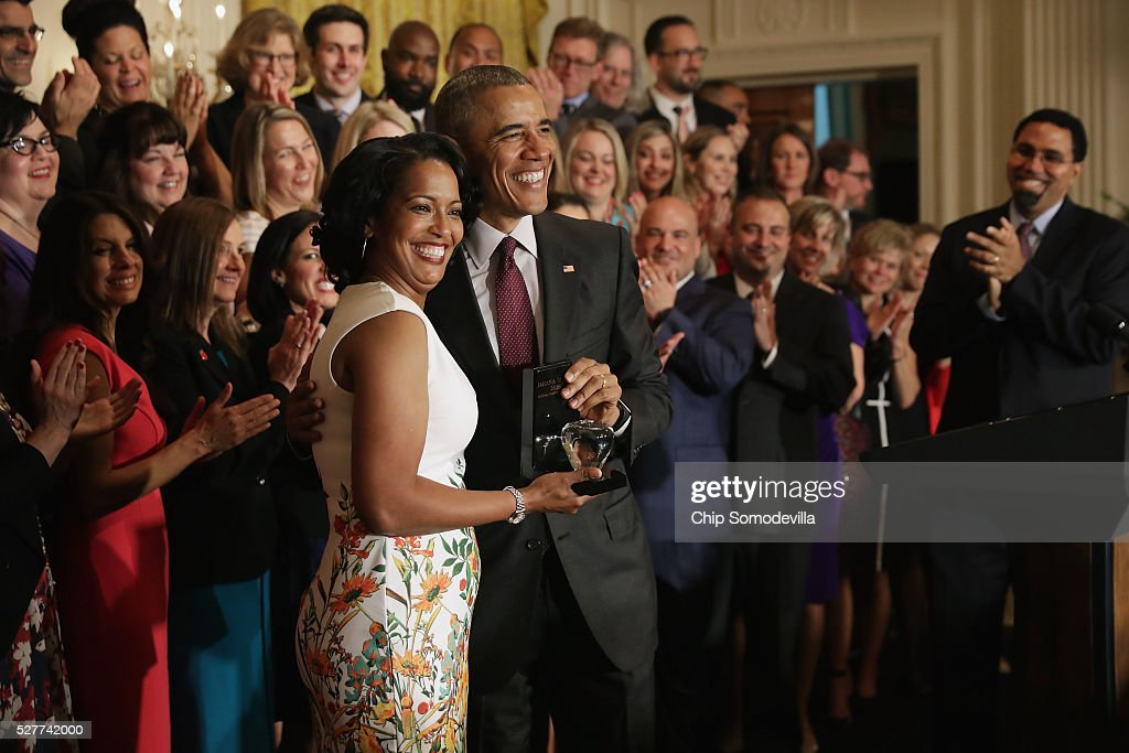 U.S. President <a gi-track='captionPersonalityLinkClicked' href=/galleries/search?phrase=Barack+Obama&family=editorial&specificpeople=203260 ng-click='$event.stopPropagation()'>Barack Obama</a> poses for photographs with 2016 National Teacher of the Year Jahana Hayes of John F. Kennedy High School in Waterbury, CT, after presenting her with the crystal apple trophy during a ceremony with the state teachers of the year in the East Room of the White House May 3, 2016 in Washington, DC. Obama talked about the influence and importance that each classroom instructor has on the lives of their students while honoring the teachers from all 50 states and U.S. territories.