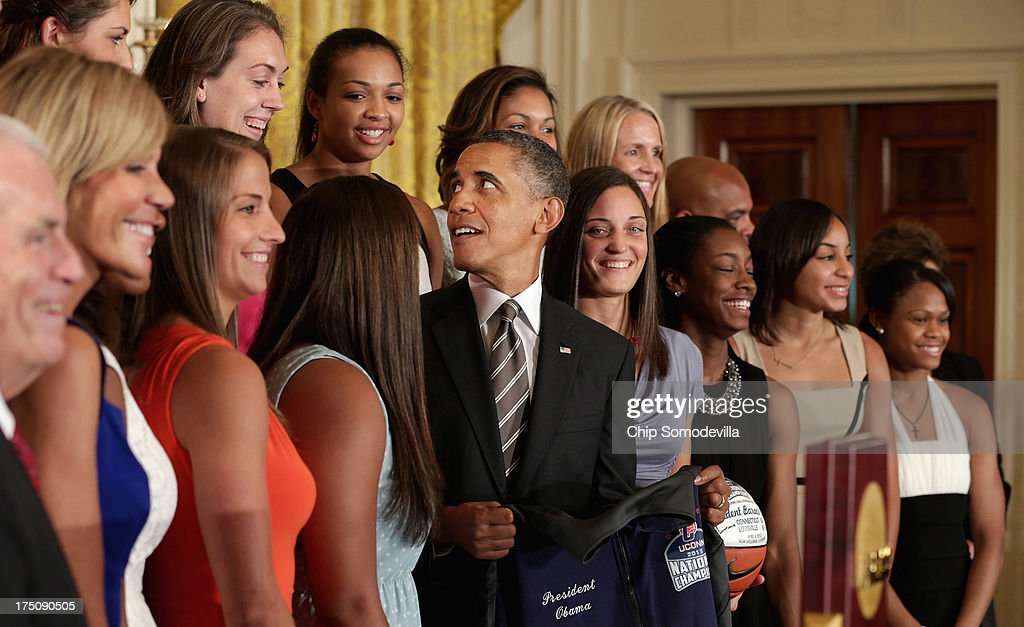 President <a gi-track='captionPersonalityLinkClicked' href=/galleries/search?phrase=Barack+Obama&family=editorial&specificpeople=203260 ng-click='$event.stopPropagation()'>Barack Obama</a> (C) poses for photographs with the 2013 NCAA champion University of Connecticut Huskies Women's basketball team in the East Room of the White House July 31, 2013 in Washington, DC. Obama hosted the team after they defeated the University of Louisville on April 9 to win their eighth national championship.