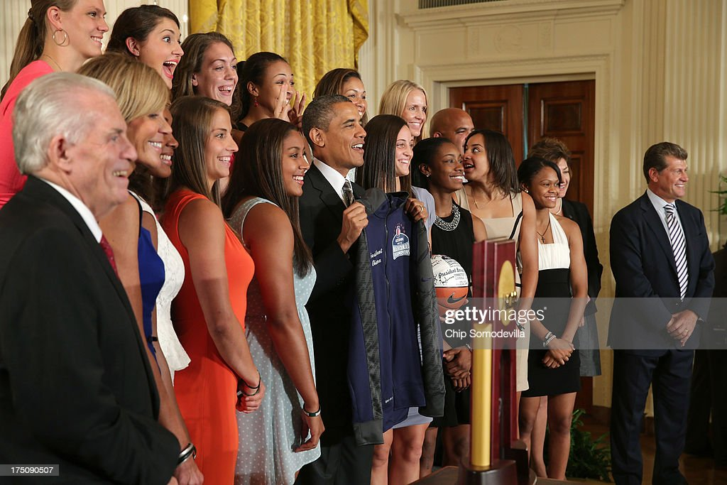 President Barack Obama (C) poses for photographs with the 2013 NCAA champion University of Connecticut Huskies Women's basketball team in the East Room of the White House July 31, 2013 in Washington, DC. Obama hosted the team after they defeated the University of Louisville on April 9 to win their eighth national championship.