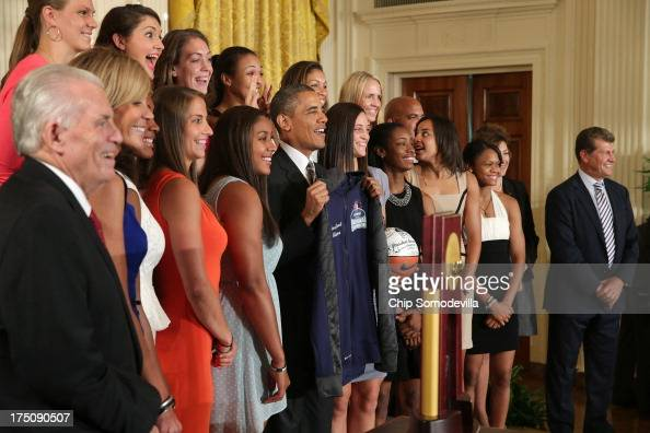 President Barack Obama poses for photographs with the 2013 NCAA champion University of Connecticut Huskies Women's basketball team in the East Room...