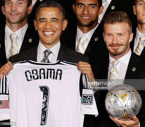 S President Barack Obama poses for photographs with the Major League Soccer champions Los Angeles Galaxy and their midfielder David Beckham in the...