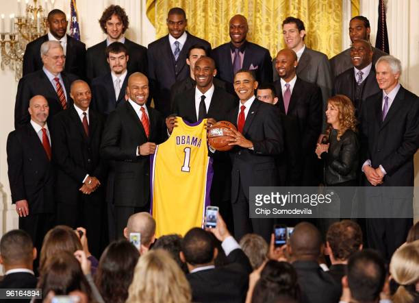 President Barack Obama poses for photographs with the National Basketball Association 2009 champions Los Angeles Lakers in the East Room of the White...