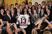 S President Barack Obama poses for photographs with the National Hockey League 2013 champion Chicago Blackhawks Coach Joel Quenneville principal...