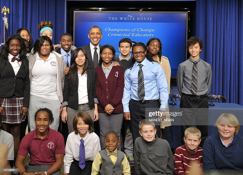 US President Barack Obama poses for photos with students after speaking at an ConnectED Initiative technology in education event in the South Court auditorium of the Eisenhower Executive Office Building, next to the White House, on November 21, 2013 in Washington, DC. AFP PHOTO/Mandel NGAN