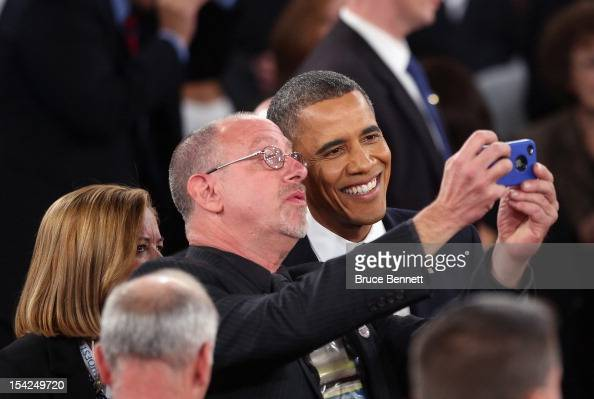 S President Barack Obama poses for pictures with members of the audience after a town hall style debate at Hofstra University October 16 2012 in...