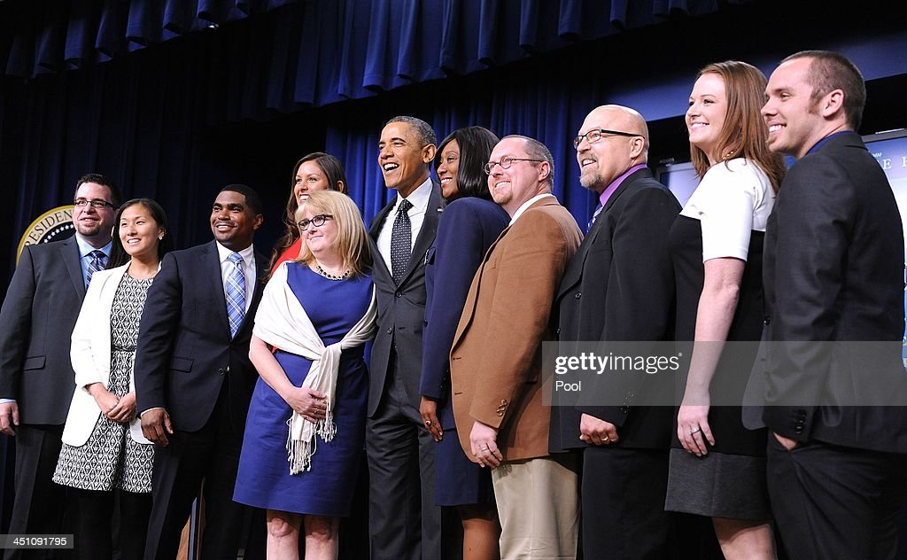 President Barack Obama poses with a group of educators in the South Court Auditorium of the White House November 21, 2013 in Washington, DC. They were being honored as ConnectED Champions of Change for taking creative approaches in using technology to enhance learning for students in communities across the country.
