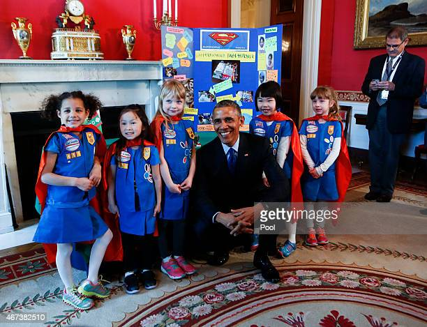 S President Barack Obama poses with a group of sixyearold Girls Scouts from Tulsa Oklahoma who designed a batterypowered page turner to help people...