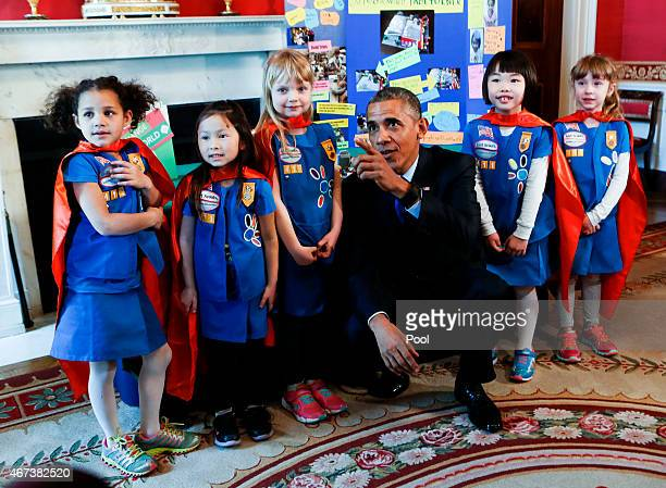 S President Barack Obama poses with a group of sixyearold Girls Scouts from Tulsa Oklahoma who designed a battery powered page turner to help people...
