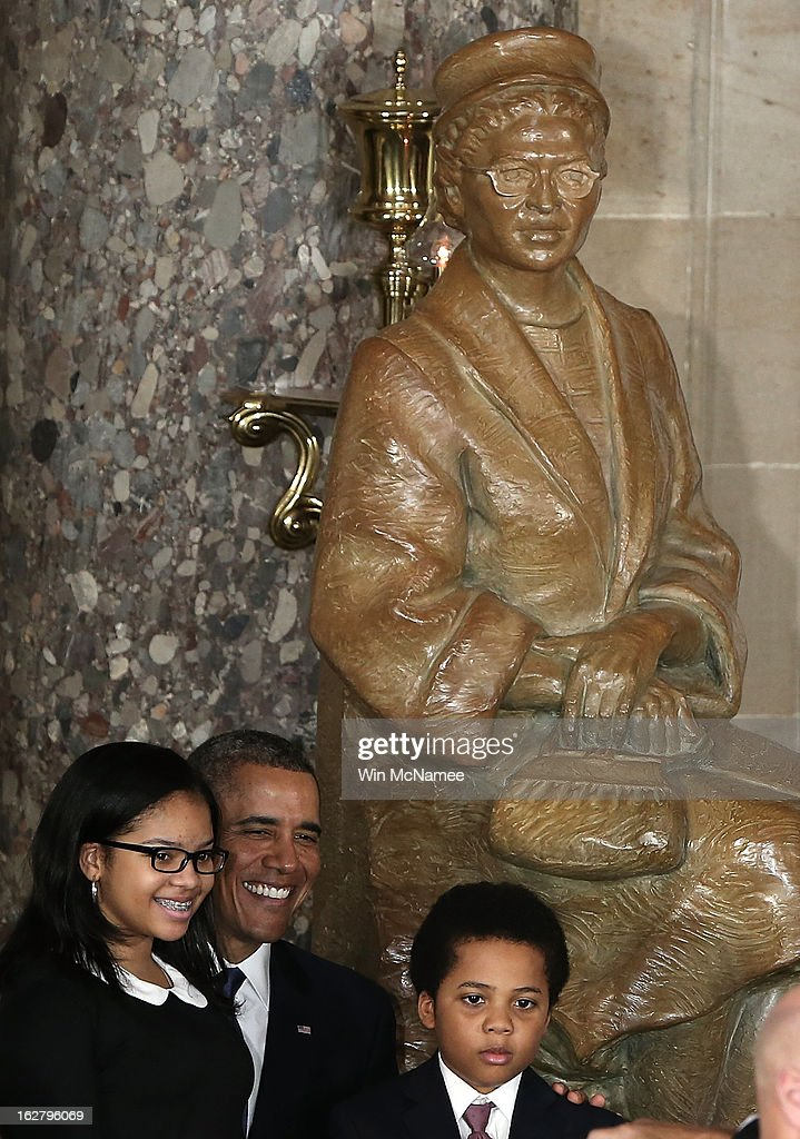 U.S. President <a gi-track='captionPersonalityLinkClicked' href=/galleries/search?phrase=Barack+Obama&family=editorial&specificpeople=203260 ng-click='$event.stopPropagation()'>Barack Obama</a> (C) poses with guests following a ceremony to unveil a statue honoring the late civil rights activist Rosa Parks in Statutory Hall of the U.S. Capitol February 27, 2013 in Washington, DC. Obama and Republican congressional leaders are still trying to find a solution to avert mandatory cuts caused by sequestration in two days.