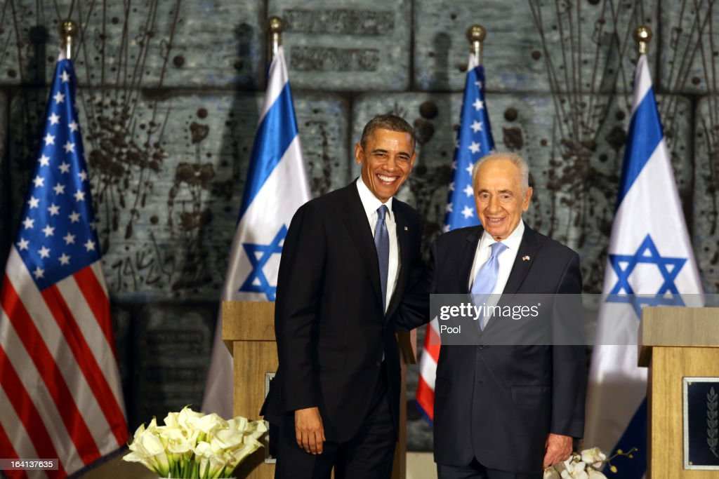 U.S. President Barack Obama (L) poses with Israeli President Shimon Peres (R) during a welcome ceremony at the President's residence on March 20, 2013 in Jerusalem, Israel. This will be Obama's first visit as president to the region, and his itinerary will include meetings with the Palestinian and Israeli leaders as well as a visit to the Church of the Nativity in Bethlehem.