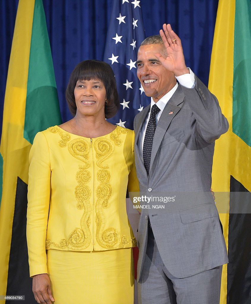 US President <a gi-track='captionPersonalityLinkClicked' href=/galleries/search?phrase=Barack+Obama&family=editorial&specificpeople=203260 ng-click='$event.stopPropagation()'>Barack Obama</a> poses with Jamaica Prime Minister Portia Simpson-Miller (L) before signing the guest book at Jamaica House on April 9, 2015 in Kingston.