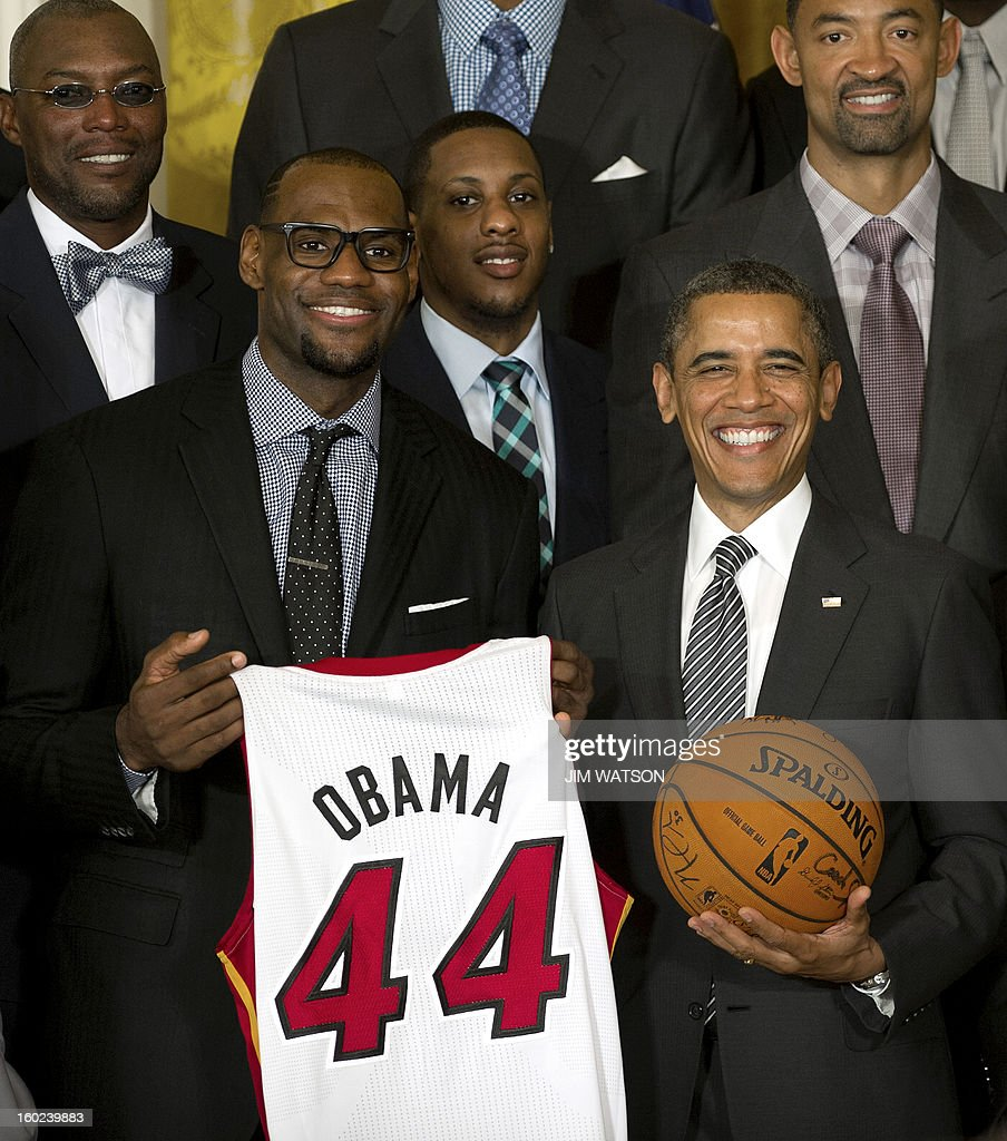 US President Barack Obama (R) poses with LeBron James as he welcomes the NBA Champion Miami Heat to the White House to honor the team and their 2012 NBA Championship victory at the White House in Washington, DC, January 28, 2013. AFP PHOTO/Jim WATSON