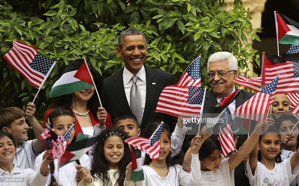 U.S. President <a gi-track='captionPersonalityLinkClicked' href=/galleries/search?phrase=Barack+Obama&family=editorial&specificpeople=203260 ng-click='$event.stopPropagation()'>Barack Obama</a> (C) poses with Palestinian kids during a visit to the Church of the Nativity with Palestinian President Mahmoud Abbas (R) on March 22, 2013 in Bethlehem, West Bank. This is Obama's first visit as president to the region and his itinerary includes meetings with the Palestinian and Israeli leaders as well as a visit to the Church of the Nativity in Bethlehem.