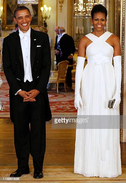 US President Barack Obama poses with US First Lady Michelle Obama in the Music Room of Buckingham Palace ahead of a State Banquet on May 24 2011 in...