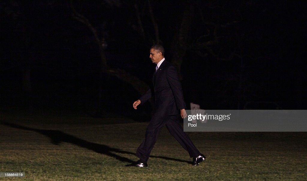 U.S. President <a gi-track='captionPersonalityLinkClicked' href=/galleries/search?phrase=Barack+Obama&family=editorial&specificpeople=203260 ng-click='$event.stopPropagation()'>Barack Obama</a> prepares to board Marine One and depart from the White House in the early morning hours of January 2, 2013 in Washington D.C.. He will return to Hawaii, after coming back to Washington DC during his holiday to work on the 'fiscal cliff' issue.