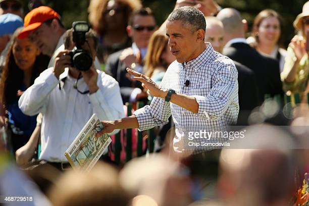 President Barack Obama prepares to read 'Where the Wild Things Are' by Maurice Sendak during the White House Easter Egg Roll on the South Lawn of the...
