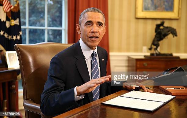 S President Barack Obama prepares to sign a Presidential Memorandum on 'Student Aid Bill of Rights' in the Oval Office of the White House on March 10...