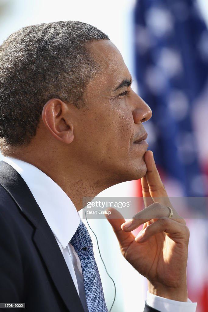 U.S. President <a gi-track='captionPersonalityLinkClicked' href=/galleries/search?phrase=Barack+Obama&family=editorial&specificpeople=203260 ng-click='$event.stopPropagation()'>Barack Obama</a> prepares to speak at the Brandenburg Gate on June 19, 2013 in Berlin, Germany. Obama is visiting Berlin for the first time during his presidency and his speech at the Brandenburg Gate is to be the highlight. Obama will be speaking close to the 50th anniversary of the historic speech by then U.S. President John F. Kennedy in Berlin in 1963, during which he proclaimed the famous sentence: 'Ich bin ein Berliner.'