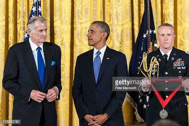 S President Barack Obama presents a 2012 National Humanities Medal to National Humanities Medal to writer Frank Deford during a ceremony in the East...