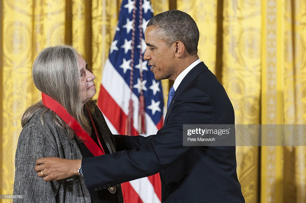 U.S. President Barack Obama (R) presents a 2012 National Humanities Medal to novelist Marilynne Robinson during a ceremony in the East Room of the White House on July 10, 2013 in Washington, DC. Robinson is recognized for her grace and intelligence in writing.