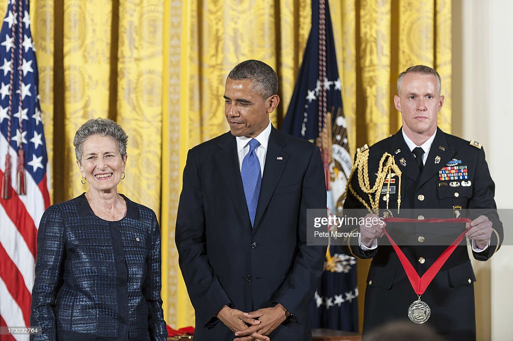 U.S. President Barack Obama (C) presents a 2012 National Humanities Medal to Canadian and American historian Natalie Zemon Davis (L) during a ceremony in the East Room of the White House on July 10, 2013 in Washington, DC. Davis is recognized for her insights into the study of history and her exacting eloquence in bringing the past into focus.