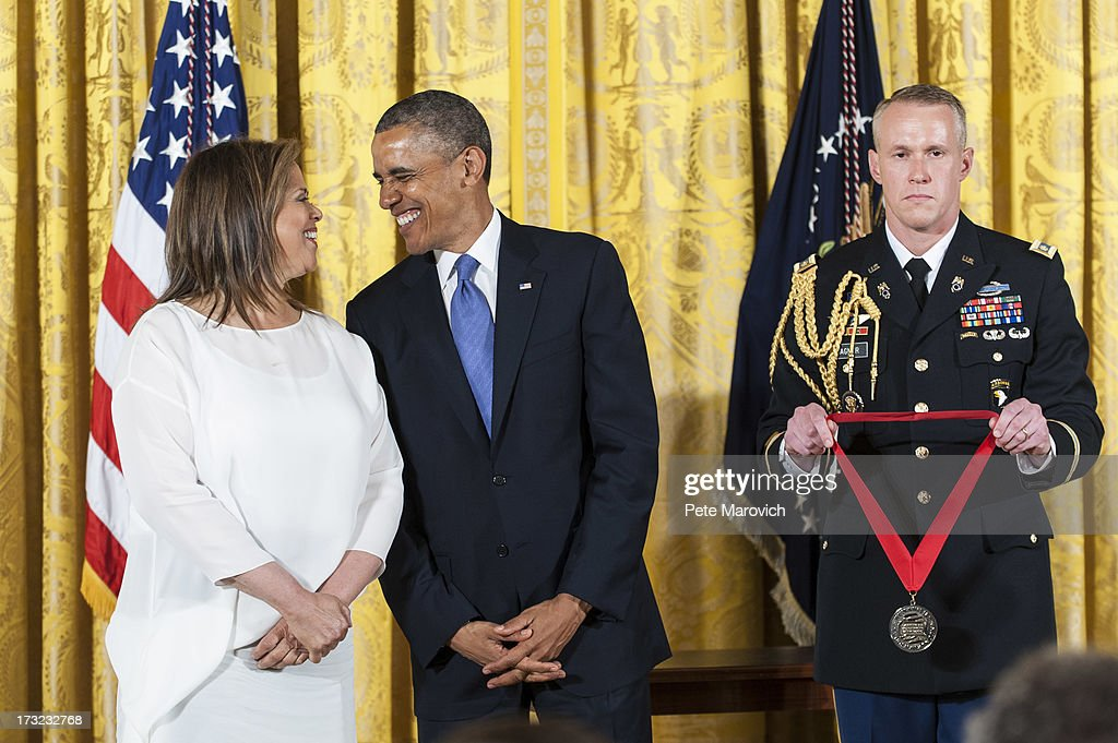 U.S. President Barack Obama presents a 2012 National Humanities Medal to American actress, playwright, and professor, Anna Deavere Smith during a ceremony in the East Room of the White House on July 10, 2013 in Washington, DC. Smith is recognized for her portrayal of authentic American voices.