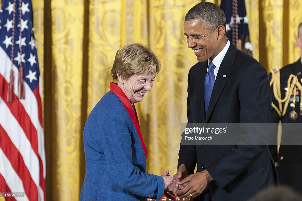 U.S. President Barack Obama (R) presents a 2012 National Humanities Medal to Australian-American author Jill Ker Conway during a ceremony in the East Room of the White House on July 10, 2013 in Washington, DC. Conway is recognized for her contributions as a historian and trailblazing academic leader.