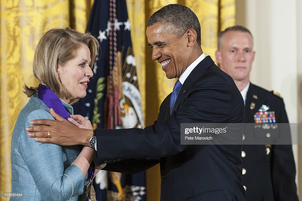 U.S. President Barack Obama presents a 2012 National Medal of Arts to Renee Fleming for her contributions to American music, during a ceremony in the East Room of the White House on July 10, 2013 in Washington, DC. Fleming has captivated audiences around the world with a repertoire spanning opera, classical, jazz and contemporary pop.