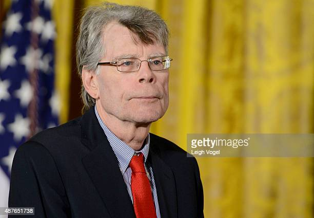 President Barack Obama presents author Stephen King with the 2014 National Medal of Arts at The White House on September 10 2015 in Washington DC