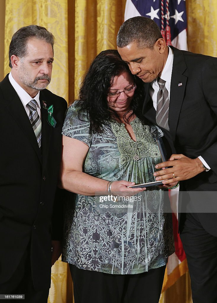 U.S. President Barack Obama presents Donna and Carlos Soto Sr. with the 2012 Presidential Citizens Medal, the nation's second-highest civilian honor, on behalf of their daughter Victoria Soto in the East Room of the White House February 15, 2013 in Washington, DC. First grad teacher, Victoria Soto was killed during a mass shooting that left 26 people dead at Sandy Hook Elementary School in December 2012. 'Their selflessness and courage inspire us all to look for opportunities to better serve our communities and our country,' Obama said about this year's recepients.