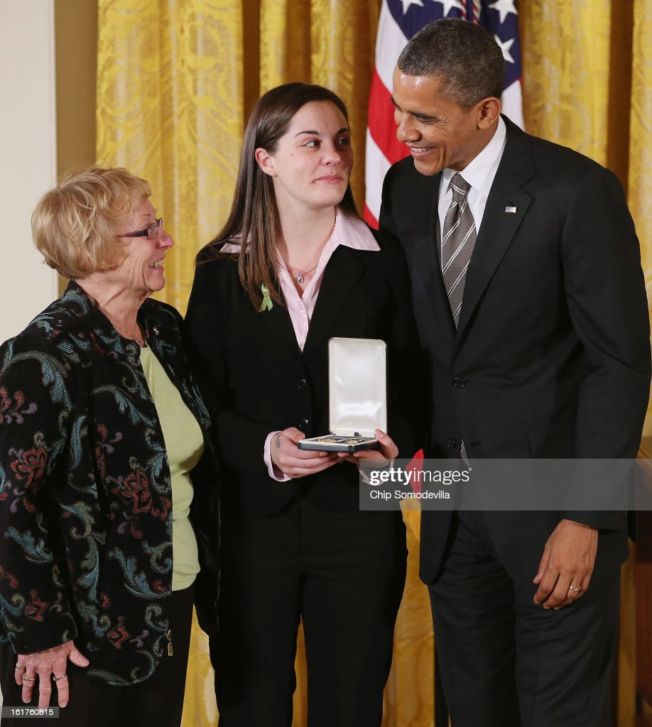 U.S. President Barack Obama presents Erica and Cheryl Lafferty with the 2012 Presidential Citizens Medal, the nation's second-highest civilian honor, on behalf of their mother and daughter Dawn Lafferty Hochsprung in the East Room of the White House February 15, 2013 in Washington, DC. Principal Dawn Lafferty Hochsprung was killed during a mass shooting that left 26 people dead at Sandy Hook Elementary School in December 2012. 'Their selflessness and courage inspire us all to look for opportunities to better serve our communities and our country,' Obama said about this year's recepients.