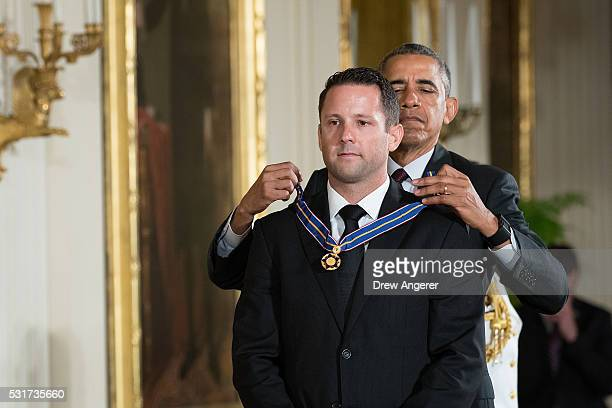S President Barack Obama presents Federal Bureau of Investigation Special Agent Tyler Call the Medal of Valor during a ceremony in the East Room of...