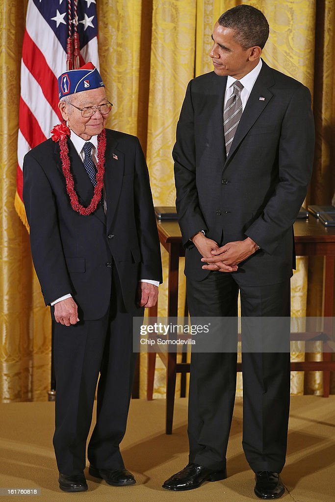 U.S. President Barack Obama presents Japanese American Veterans Association Executive Director Terry Shima with the 2012 Presidential Citizens Medal, the nation's second-highest civilian honor, in the East Room of the White House February 15, 2013 in Washington, DC. 'Their selflessness and courage inspire us all to look for opportunities to better serve our communities and our country,' Obama said about this year's recepients.