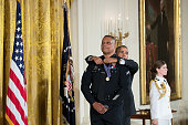 S President Barack Obama presents Los Angeles Police Officer Donald Thompson the Medal of Valor during a ceremony in the East Room of the White House...