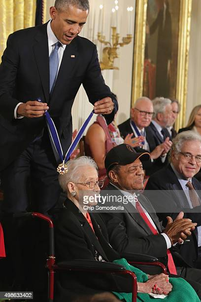 S President Barack Obama presents pioneering NASA mathematician Katherine Johnson with the Presidential Medal of Freedom as Willie Mays and Itzhak...