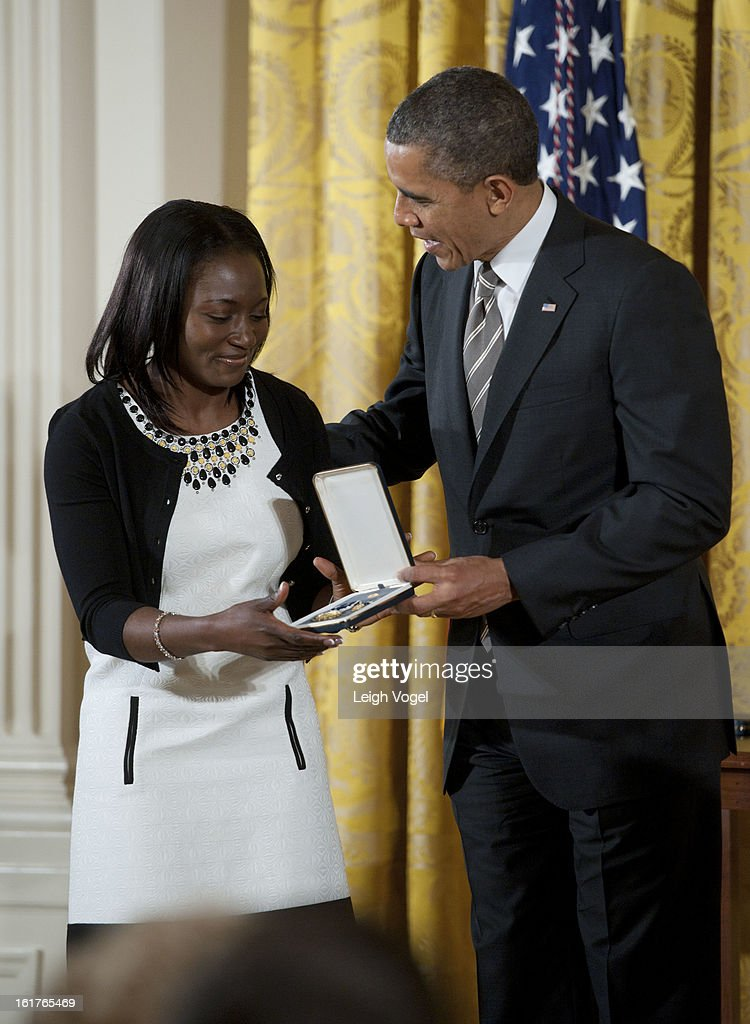 President Barack Obama presents Project SHINE's Patience Lehrman with the 2012 Presidential Citizens Medal at the White House on February 15, 2013 in Washington, DC.