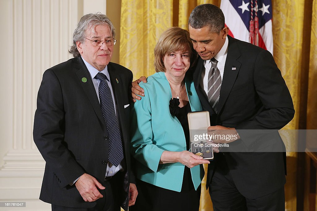 U.S. President Barack Obama presents Terri Rousseau and Gilles Rousseau; with the 2012 Presidential Citizens Medal, the nation's second-highest civilian honor, on behalf of their daughter Lauren Rousseau in the East Room of the White House February 15, 2013 in Washington, DC. First grade teacher Lauren Rousseau was killed during a mass shooting that left 26 people dead at Sandy Hook Elementary School in December 2012. 'Their selflessness and courage inspire us all to look for opportunities to better serve our communities and our country,' Obama said about this year's recepients.
