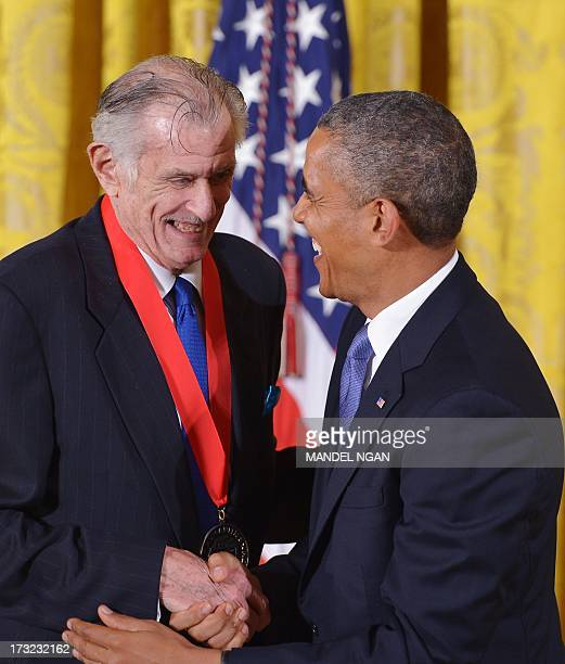 US President Barack Obama presents the 2012 National Humanities Medal to sports writer Frank Deford during a ceremony in the East Room of the White...