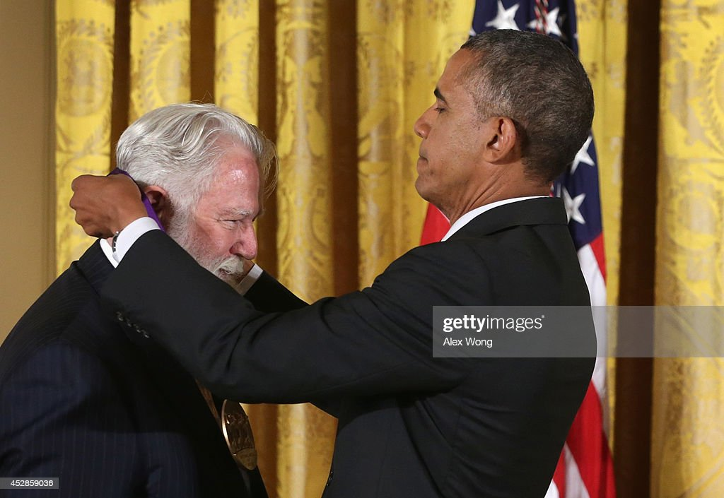 S President Barack Obama presents the 2013 National Medal of Arts to visual artist James Turrell during an East Room ceremony July 28 2014 at the...