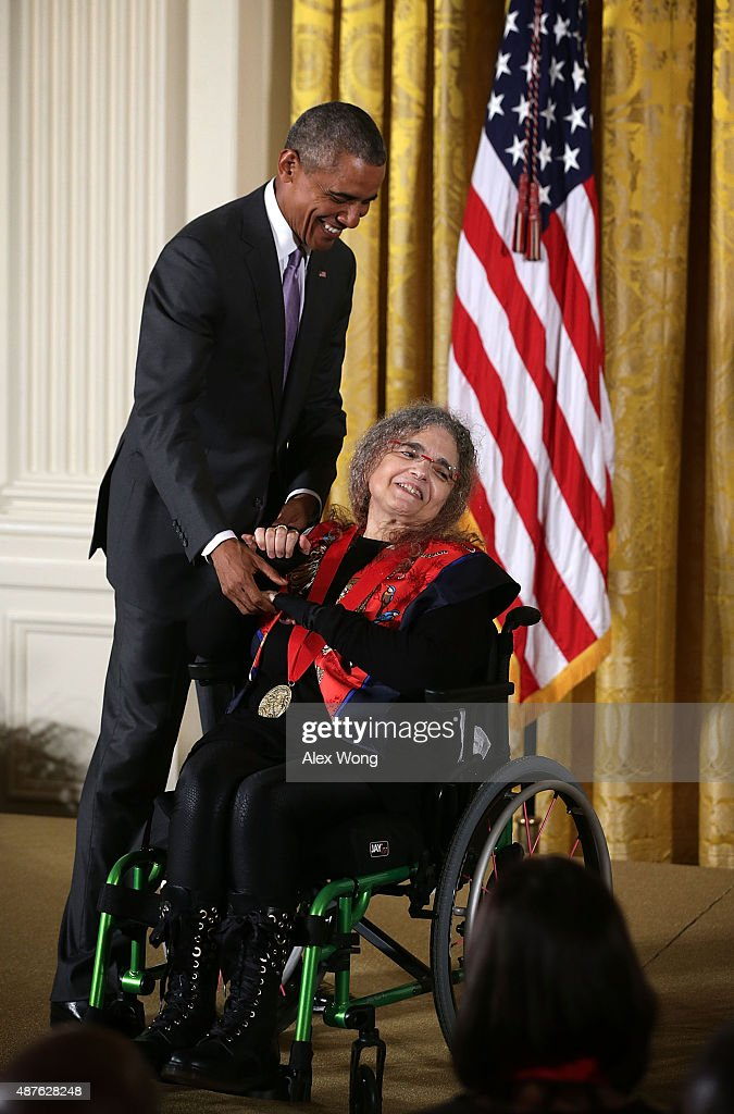 U.S. President Barack Obama (L) presents the 2014 National Humanities Medal to Fedwa Malti-Douglas (R) during an East Room ceremony at the White House September 10, 2015 in Washington, DC. Fedwa Malti-Douglas was honored for her studies of Arabic letters.