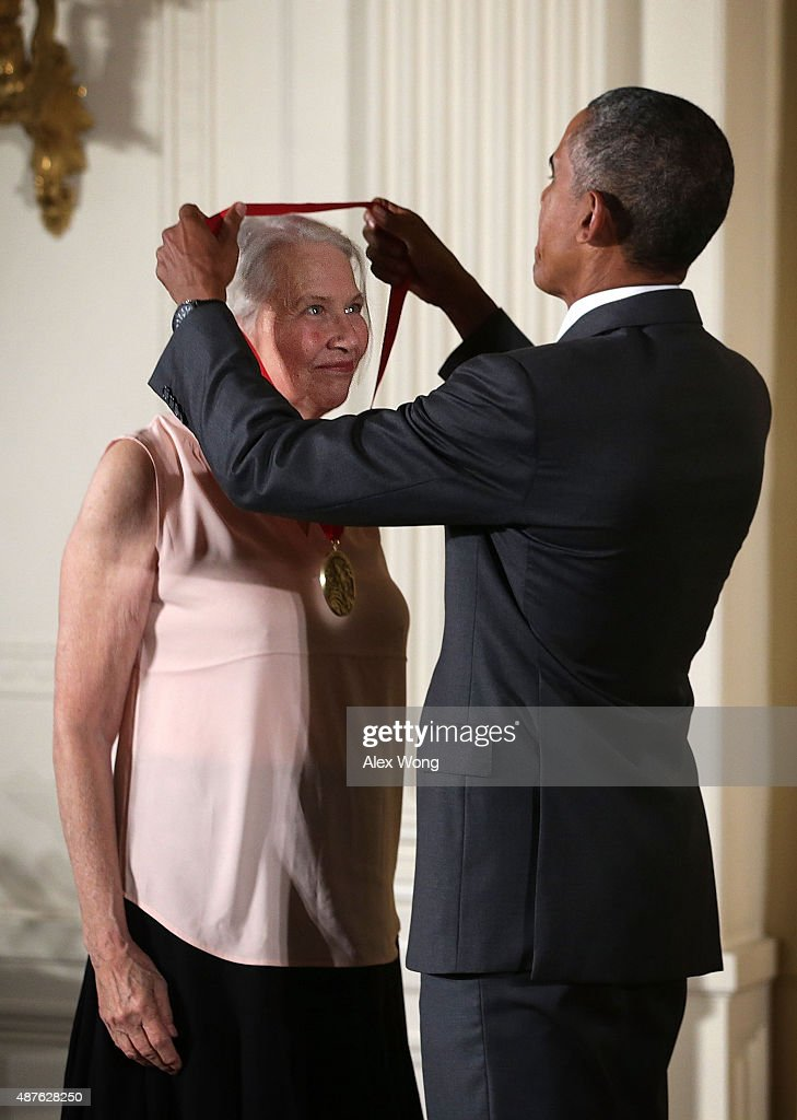 U.S. President Barack Obama (R) presents the 2014 National Humanities Medal to Annie Dillard (L) during an East Room ceremony at the White House September 10, 2015 in Washington, DC. Annie Dillard was honored for her profound reflections on human life and nature in poetry and in prose.
