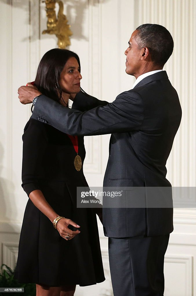 U.S. President Barack Obama presents the 2014 National Humanities Medal to Jhumpa Lahiri during an East Room ceremony at the White House September 10, 2015 in Washington, DC. Jhumpa Lahiri was honored for enlarging the human story in her works of fiction.