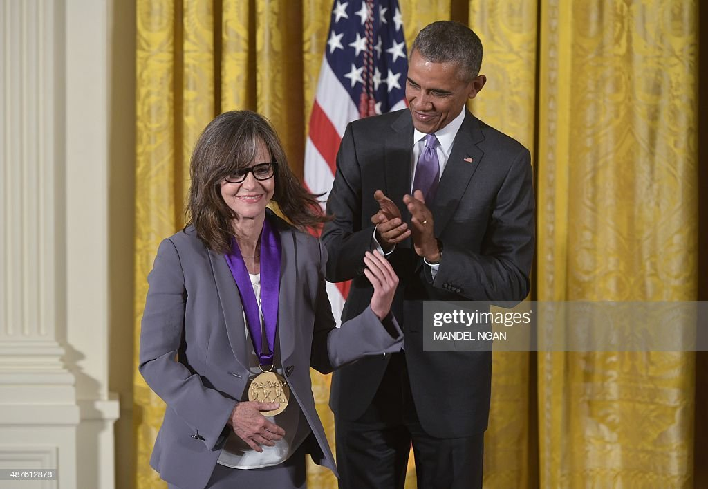 US President Barack Obama presents the 2014 National Medal of Arts to actress and filmmaker Sally Field during a ceremony in the East Room of the White House on September 10, 2015 in Washington, DC.