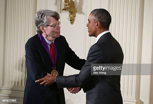 S President Barack Obama presents the 2014 National Medal of Arts to Stephen King during an East Room ceremony at the White House September 10 2015...