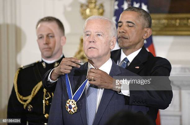 US President Barack Obama presents the Medal of Freedom to VicePresident Joe Biden during an event in the State Dining room of the White House...