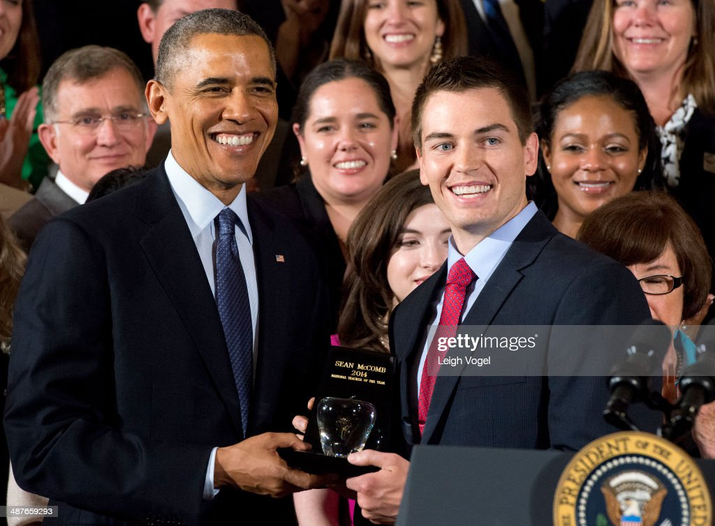 U.S. President <a gi-track='captionPersonalityLinkClicked' href=/galleries/search?phrase=Barack+Obama&family=editorial&specificpeople=203260 ng-click='$event.stopPropagation()'>Barack Obama</a> presents the National Teacher of the Year Award to Sean McComb at the White House on May 1, 2014 in Washington, DC.