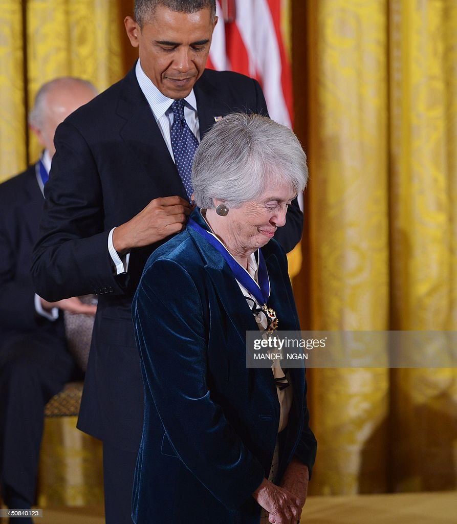 US President Barack Obama presents the Presidential Medal of Freedom to former judge Patricia Wald during a ceremony in the East Room of the White House on November 20, 2013 in Washington, DC. The Medal of Freedom is the country's highest civilian honor. AFP PHOTO/Mandel NGAN